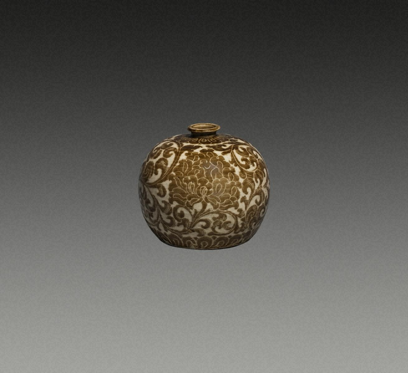 BOTTLE, Porcelain with sgraffito peony scroll design carved through underglaze iron-brown slip