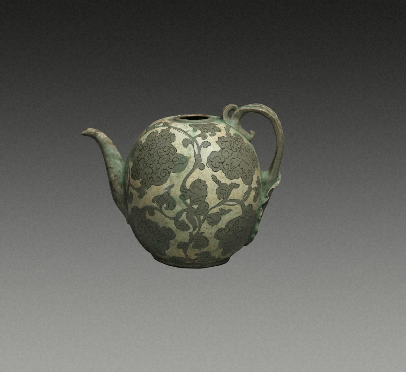EWER, Celadon with inlaid design of boys and baoxianghua scroll